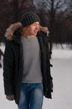Young blond man walking in winter Park Royalty Free Stock Photos