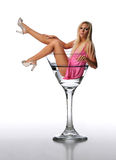Young Blond in a martini glass Royalty Free Stock Photography