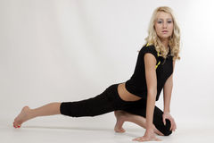 Young blond model. Exercising and stretching Stock Image