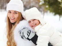 Young blond mother with daughter having fun outdoors Royalty Free Stock Images