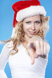 Young blond pretty Santa woman pointing at you Stock Photography