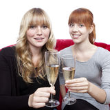 Young blond and red haired girls with champagne Stock Images
