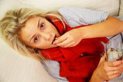 Young blond sick woman Stock Photography