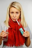 Young blond sick woman Royalty Free Stock Image