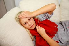 Young blond sick woman Stock Photo
