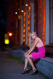 Young blond sits on parapet royalty free stock image