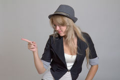 Young woman in hat pointing Stock Photography