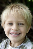 Young blond smiling boy five years old Royalty Free Stock Image
