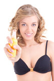 Young blond spraying lotion over white background Royalty Free Stock Image