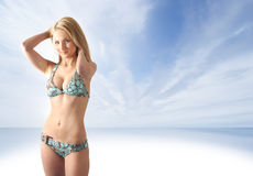 A young blond is standing in light blue lingerie Royalty Free Stock Images
