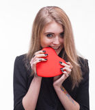 Young blond tasting heart Royalty Free Stock Photo