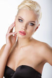 Young Blond Touching her Face with Clean Healthy Skin. Blond Touching her Face with Clean Healthy Skin royalty free stock photography
