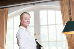Young blond waitress in a restaurant Royalty Free Stock Photo