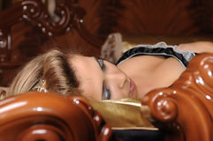 Young blond woman. A nice close up of a young blond woman with the head on pillow and sleeping Stock Photo