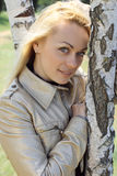 Young blond woman. Portrait among birch Stock Photo