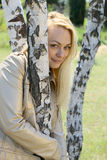 Young blond woman. Portrait among birch Royalty Free Stock Photography