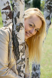 Young blond woman. Portrait among birch Stock Photography