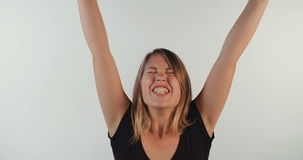 Young blond woman acting surprised and happy