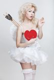 Young blond woman in angel costume Royalty Free Stock Photo