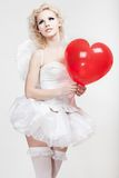 Young blond woman in angel costume Royalty Free Stock Image