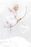 Young blond woman in angel costume Stock Photos