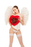 Young blond woman in angel costume holding heart Royalty Free Stock Photo