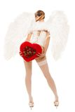 Young blond woman in angel costume holding heart royalty free stock photos