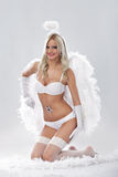 Young blond woman as angel Stock Images