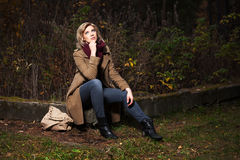 Young blond woman in autumn forest Royalty Free Stock Images