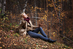 Young blond woman in autumn forest Stock Photo