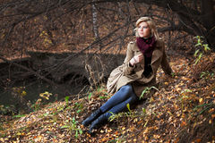 Young fashion blond woman in autumn forest Royalty Free Stock Photo