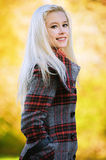 Young blond woman at autumn park Stock Image