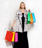 Young blond woman with bags Royalty Free Stock Images