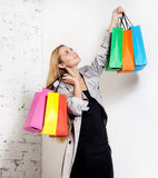 Young blond woman with bags Stock Photos