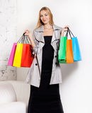 Young blond woman with bags Royalty Free Stock Image
