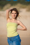 Young blond woman at the beach Stock Photography