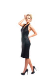 A young blond woman in a beautiful black dress Royalty Free Stock Photos