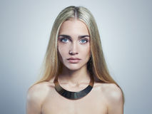 Young blond woman.Beautiful Girl.blonde in necklace Royalty Free Stock Image
