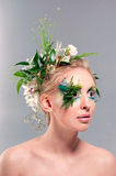 Young blond woman beauty portrait with wreath of flowers, studio Stock Photos