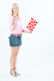 Young blond woman with big valentine post card Stock Photos