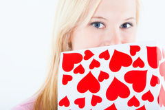 Young blond woman with big valentine post card Royalty Free Stock Photos