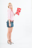 Young blond woman with big valentine post card Royalty Free Stock Photography