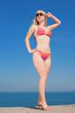Young blond woman in bikini outdoors Royalty Free Stock Photo