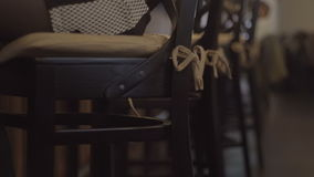 Young blond woman in black shoes sitting on a chair in the bar stock video footage