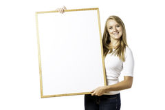 Young, blond woman with blank board royalty free stock photos