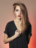 Young blond woman with blue eyes.Beautiful blonde Girl. Make-up and red lips royalty free stock images