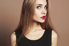 Young blond woman with blue eyes.Beautiful blonde Girl Stock Image