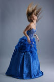 A young blond woman in blue wedding dress Stock Images
