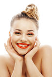 Young blond woman with bright make up smiling Stock Photography