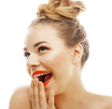 Young blond woman with bright make up smiling pointing gesturing emotional isolated like doll lashes Stock Photo